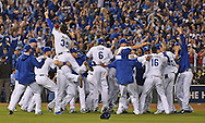 Oct 23, 2015; Kansas City, MO, USA; Kansas City Royals players celebrate on the field after defeating the Toronto Blue Jays in game six of the ALCS at Kauffman Stadium.