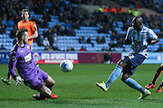 Colchester United goalkeeper Elliott Parish (33) saves from Coventry City forward Marc-Antoine Fortune (32)  during the Sky Bet League 1 match between Coventry City and Colchester United at the Ricoh Arena, Coventry, England on 29 March 2016. Photo by Simon Davies.