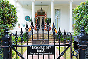 Beware of Dog joke sign on traditional grand mansion house in the Garden District of New Orleans, Louisiana, USA