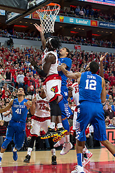 Louisville forward Montrezl Harrell, left, blocks a shot by Kentucky forward Willie Cauley-Stein in the first half. <br /> <br /> The University of Louisville hosted the University of Kentucky, Saturday, Dec. 27, 2014 at The Yum Center in Louisville.