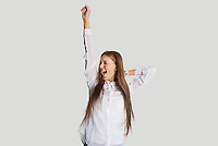Excited woman with arm raised screaming against white background