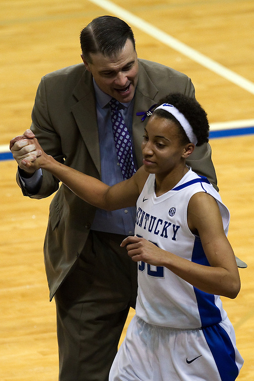 UK head coach Matthew Mitchell, left, congratulates guard Kastine Evans as she leaves the game for the last time in the second half. The University of Kentucky Women hosted Mississippi State University Thursday, Jan. 17, 2013 at Memorial Coliseum in Lexington. Photo by Jonathan Palmer