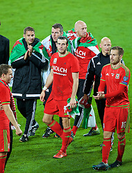 CARDIFF, WALES - Tuesday, October 13, 2015: Wales' Gareth Bale and Aaron Ramsey celebrates on the pitch after qualifying for the finals following a 2-0 victory over Andorra during the UEFA Euro 2016 qualifying Group B match at the Cardiff City Stadium. sports science coach Adam Owen, Ronan Kavanagh, James Collins, Paul Harris. (Pic by Paul Currie/Propaganda)