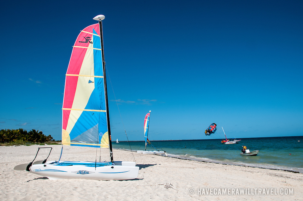 A catamaran sits on the white sandy beach at Playa Mujeres, north of Cancun, Quintana Roo, Mexico