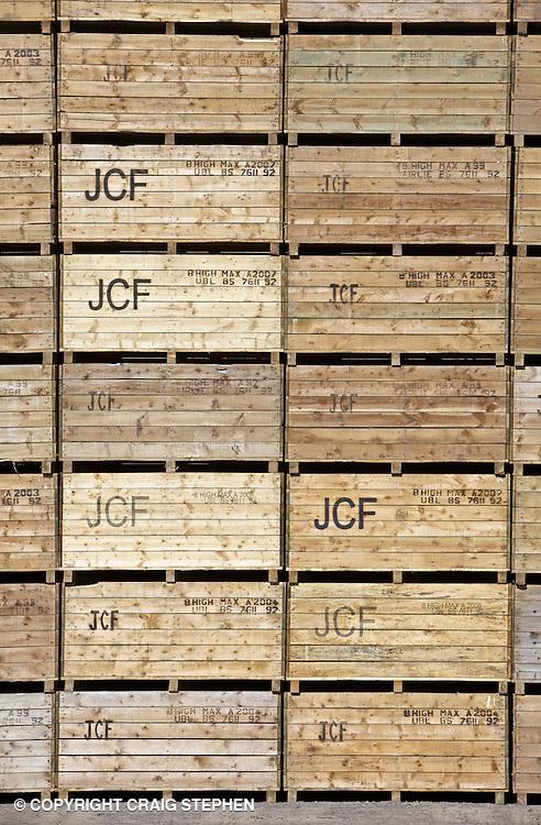 Stacks of empty wooden potato boxes at a potato merchants in Perthshire, Scotland