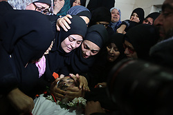 April 26, 2018 - Gaza, gaza strip, Palestine - Relatives of Palestinian journalist Ahmed Abu Hussein, 24, who died of wounds he sustained while covering a protest along the Gaza-Israel border, mourns during his funeral in the northern Gaza Strip, April 26, 2018. (Credit Image: © Majdi Fathi/NurPhoto via ZUMA Press)