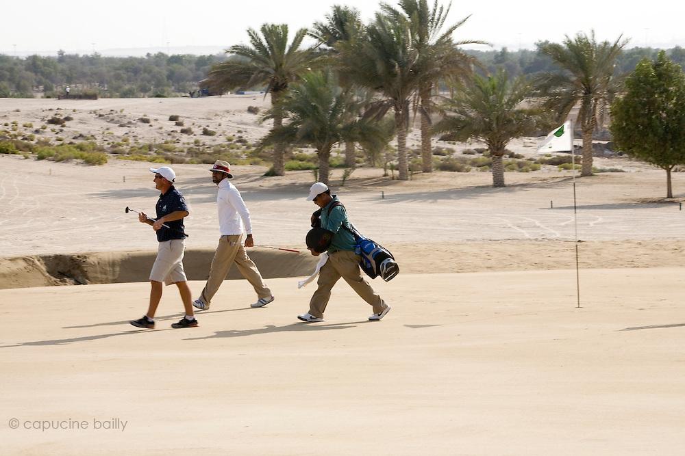 Abu Dhabi, United Arab Emirates (UAE). .March 20th 2009..Al Ghazal Golf Club..36th Abu Dhabi Men's Open Championship..Paul King (left) and Abdulla Al Musharrekh (middle)