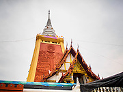 11 JANUARY 2015 - BANGKOK, THAILAND:  The main chedi at Wat Dhamma Mongkol. Wat Dhamma Mongkol, (pronounced 'Dhammamongkon') is on the edge of Bangkok, and visible from a number of places, especially from the elevated expressways around the city. The temple was started in the early 1960s by a revered monk who had spent more than 20 years in a forest retreat. The 95 meter high tower, completed in 1985, is a modern rendition of the tower that now marks the place of the Buddha's enlightenment in Bodhgaya, India. There are classrooms, a museum and meditation area inside the tower. The largest Buddha statue carved from a single piece of jade is on the temple grounds.   PHOTO BY JACK KURTZ