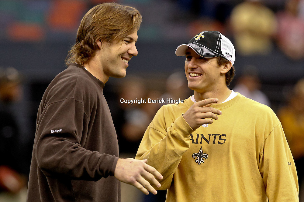 Oct 24, 2010; New Orleans, LA, USA; Former teammates Cleveland Browns linebacker Scott Fujita and New Orleans Saints quarterback Drew Brees (9) talk prior to kickoff of a game at the Louisiana Superdome. Mandatory Credit: Derick E. Hingle