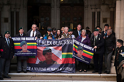 © Licensed to London News Pictures. 16/12/2016. London, UK. Supporters of Sgt Alexander Blackman line the steps of The High Court after attending his bail hearing. Sgt Alexander Blackman is currently serving a life sentence after being convicted of murdering a wounded Taliban fighter in Afghanistan in 2011. Photo credit: Peter Macdiarmid/LNP