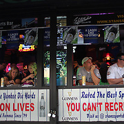 Fans enjoy a drink in a bar near Yankee stadium before the New York Yankees V New York Mets Subway Series Baseball game at Yankee Stadium, The Bronx, New York. 8th June 2012. Photo Tim Clayton
