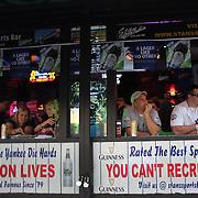 Fans enjoy a drink in a bar near Yankee stadium before the New York Yankees V New York Mets Subway Series Baseball game at Yankee Stadium, The Bronx, New York. 8th June 2012. Photo Tim Clayton