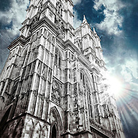 The sun peeks over the magnificent Westminster Abbey in London
