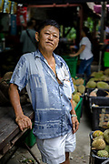 Tan Eow Chong stands for a portrait at Durian Kaki, Tan Eow Chong's roadside durian stall, in Bayan Lepas, Pulau Pinang, Malaysia on June 17th, 2019. Tan Eow Chong is an award-winning durian farmer famed for his Musang King variety, and last year exported 1000 tons of the fruit to China from his family-run durian empire, expanding from an 80 acre farm to 1000 acres.  Photo by Suzanne Lee/PANOS for Los Angeles Times