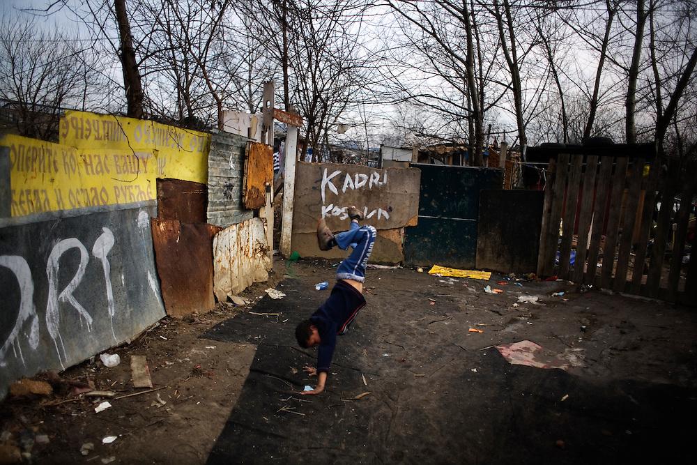A child doing a summersault in the New Belgrade settlement of Belville.