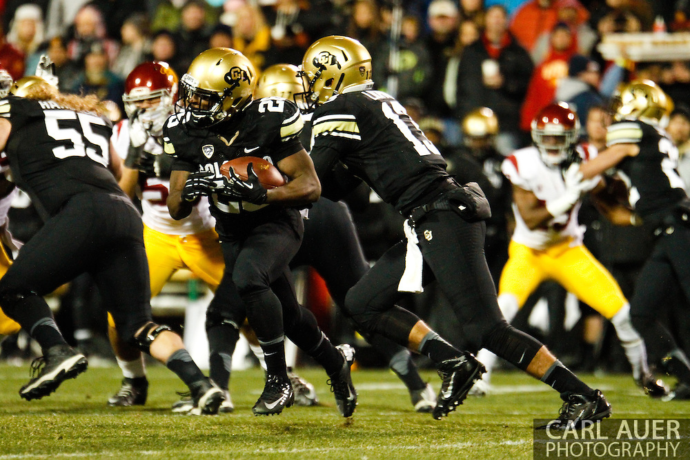 November 23rd, 2013:  Colorado Buffaloes junior tail back Tony Jones (26) runs the ball in the first quarter of the NCAA Football game between the University of Southern California Trojans and the University of Colorado Buffaloes at Folsom Field in Boulder, Colorado
