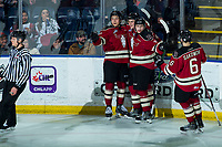 KELOWNA, BC - FEBRUARY 15: Jace Isley #18, Ben King #14, Christoffer Sedoff #4 and Ethan Sakowich #6 of the Red Deer Rebels celebrate a third period goal against the Kelowna Rockets at Prospera Place on February 15, 2020 in Kelowna, Canada. (Photo by Marissa Baecker/Shoot the Breeze)
