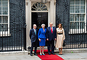Donald Trump, US President and First Lady Melania Trump arrive in Downing Street as part of their State visit. Theresa May, Prime Minister and Mr May greet them on the doorstep of No.10 Downing Street, London, Great Britain <br />