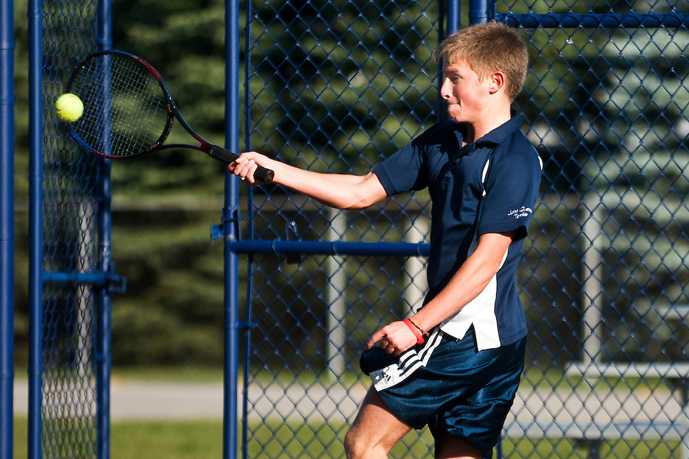 Lathan Goumas | The Bay City Times..Mitch Eigner of the John Glenn High School tennis team hits the ball during the 2011 City By the Bay Invitational Tennis Tournament at Garber High School in Essexville, MI., on Saturday September 24, 2011.