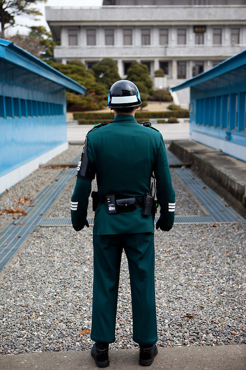 "A South Korean soldier at the Joint Security Area (JSA). The Joint Security Area or Panmunjom, often called the ""Truce Village""  is the only portion of the Korean Demilitarized Zone (DMZ) where South and North Korean forces stand face-to-face. The area is used by the two Koreas for diplomatic engagements and, until March 1991, was also the site of military negotiations between North Korea and the United Nations Command (UNC). South Korea, Republic of Korea, KOR, 23rd of March 2010."