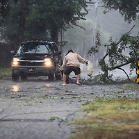 A man moves a large tree limb that downed power lines Friday, Sept. 14, 2018, as Hurricane Francis hit North Myrtle Beach's Cherry Grove community. Andrew Knapp/Staff
