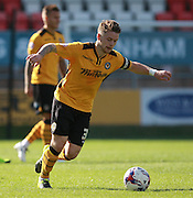 Newport County player Mark Byrne spreads the play during the Sky Bet League 2 match between Dagenham and Redbridge and Newport County at the London Borough of Barking and Dagenham Stadium, London, England on 19 September 2015. Photo by Bennett Dean.