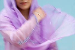 The swish of a traditional Asian sari,