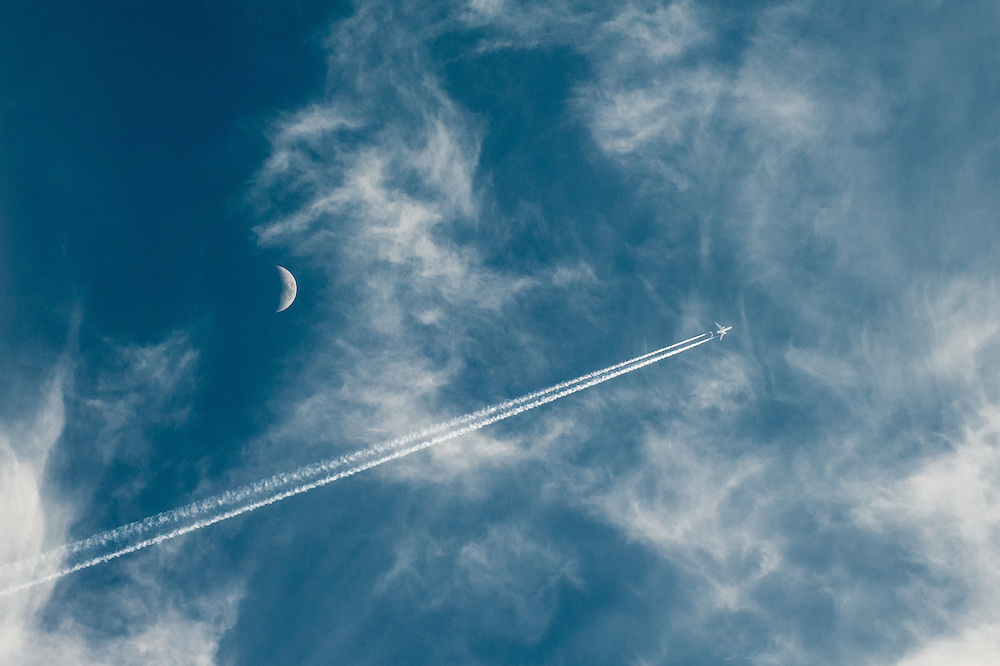 An airliner with contrails is seen over Busan.
