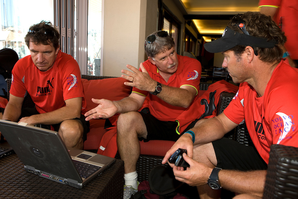 15NOV08. Ken Campbell (centre) and Will Oxley (left) give a weather briefing to Neil Cox, Il Mostro's shore manager, to give an idea of what the boat can expect on Leg 2 Start of the Volvo Ocean Race 2008-09 from Cape Town to Kochi.