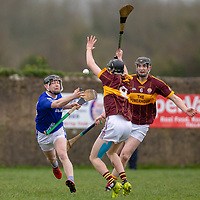 Kilmaley's Michael O'Malley hand passes the ball away from Tulla's Niall Bolton and Colm McInerney