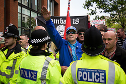 "© Licensed to London News Pictures . 22/08/2015 . Manchester , UK . A far-right protester performs a Nazi salute . Far-right nationalist group , "" North West Infidels "" and Islamophobic , anti-Semitic and white supremacist supporters , hold a rally in Manchester City Centre . Photo credit : Joel Goodman/LNP"