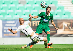 Josip Fucek of Krka vs Boban Jovic #5 of Olimpija during football match between NK Olimpija and NK Krka in Round 1 of Prva liga Telekom Slovenije 2014/15, on July 19, 2014 in SRC Stozice, Ljubljana, Slovenia. Photo by Vid Ponikvar / Sportida.com