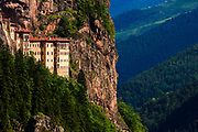 Ancient Greek monastery nestled in a steep cliff