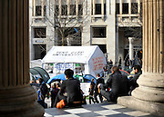 © Licensed to London News Pictures. 23/02/2012, London, UK. The 'Tent City University' seen from the main door of St Pauls' Cathedral, London. Protesters start to pack up at the Occupy London Stock Exchange site in front of St Paul's Cathedral on February 23rd 2012. Protesters at the site have been refused permission to appeal against their eviction from the Occupy London camp.. Photo credit : Stephen Simpson/LNP