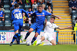 Peterborough United's Jack Baldwin tackles Rochdale's George Donnelly - Photo mandatory by-line: Joe Dent/JMP - Mobile: 07966 386802 09/08/2014 - SPORT - FOOTBALL - Rochdale - Spotland Stadium - Rochdale AFC v Peterborough United - Sky Bet League One - First game of the season