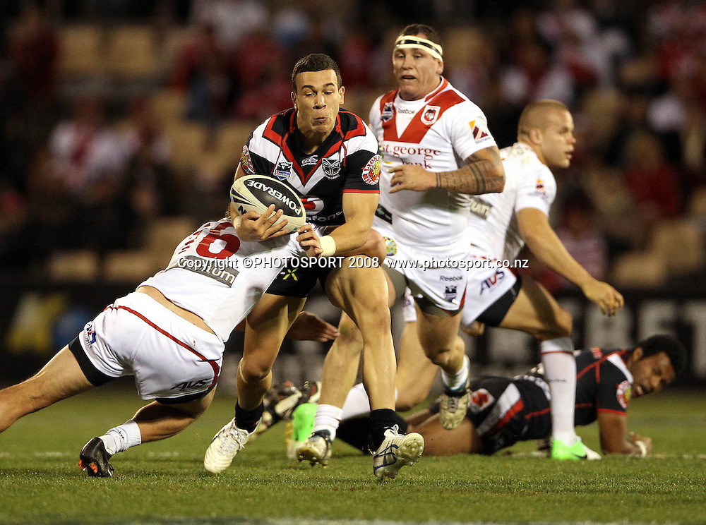 Carlos Tuimavave tackled by Will Matthews<br /> Dragons v Warriors. NRL rugby league match. WIN Stadium, Wollongong Australia. Saturday 25 August 2012. Photo: Paul Seiser/PHOTOSPORT