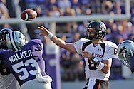 MANHATTAN, KS - OCTOBER 04:  Quarterback Graham Harrell #6 of the Texas Tech Red Raiders throws the ball down field against pressure from linebacker Reggie Walker #53 of the Kansas State Wildcats in the first half on October 4, 2008 at Bill Snyder Family Stadium in Manhattan, Kansas.  Texas Tech won 58-29