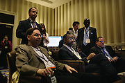 Dr. Ben Carson, center, a retired neurosurgeon, waits in the green room before speaking during the final day of the Conservative Political Action Conference (CPAC) at the Gaylord National Resort & Convention Center in National Harbor, Md.