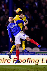 Tom Lockyer of Bristol Rovers contends for the aerial ball with James Vaughan of Portsmouth - Mandatory by-line: Ryan Hiscott/JMP - 19/02/2019 - FOOTBALL - Fratton Park - Portsmouth, England - Portsmouth v Bristol Rovers - Sky Bet League One