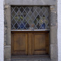 Pane glass and wood old window, the Palace, in the historical village of Culross, West Fife, Scotland<br />