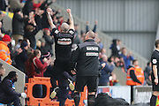 Jim Bentley Manager of Morecambe FC and 1st Assistant Ken McKenna salute the home crowd after Jamie Devitt of Morecambe FC put Morecambe 2-0 up during the Sky Bet League 2 match between Morecambe and AFC Wimbledon at the Globe Arena, Morecambe, England on 12 March 2016. Photo by Stuart Butcher.