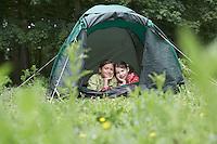 Two girls (7-9) in tent portrait