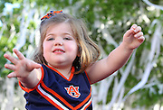 AUBURN, AL - APRIL 20:  A young Auburn fan waits to catch a roll of toilet paper during the Auburn Oaks at Toomer's Corner Celebration on April 20, 2013 in Auburn, Alabama.  (Photo by Mike Zarrilli/Getty Images)
