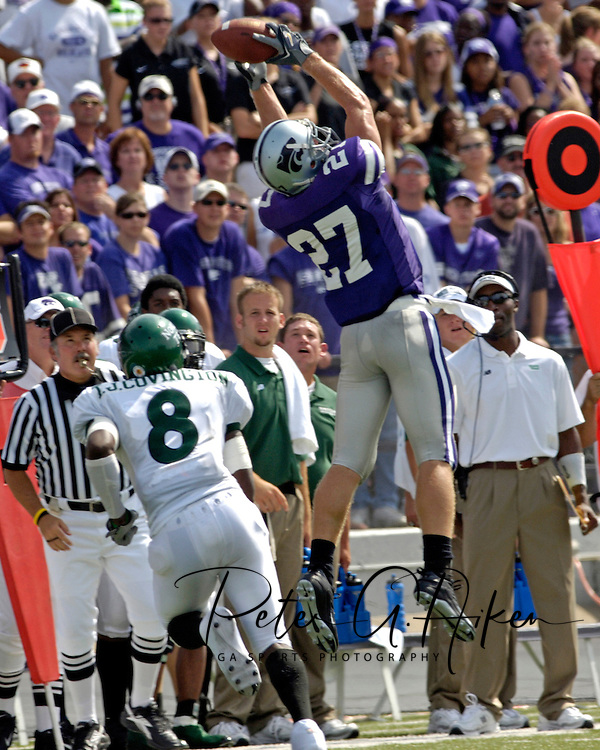 Kansas State wide receiver Jordy Nelson (27) goes up high to pull in the pass along the sideline over North Texas defensive back T.J. Covington (8) in the first quarter. Kansas State defeated the Mean Green of North Texas 54-7 at KSU Stadium in Manhattan, Kansas on September 24, 2005.