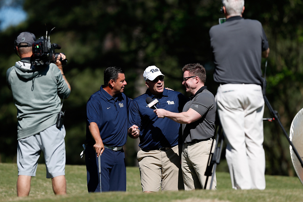 John Congemi and Pat Narduzzi talk to ESPN during the Chick-fil-A Peach Bowl Challenge at the Oconee Golf Course at Reynolds Plantation, Sunday, May 1, 2018, in Greensboro, Georgia. (Paul Abell via Abell Images for Chick-fil-A Peach Bowl Challenge)