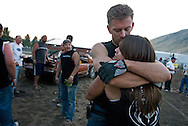 NEWS&GUIDE PHOTO / PRICE CHAMBERS.Shaun King and Danielle Raver embrace after the final heat at the Teton County Fair Demolition Derby on Sunday. King's car bit the dust in the semi-finals and Raver's choked out in her first heat, not to start again.