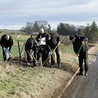 Five dead in a road traffic accident on the A85 Perth to Crieff road near Burnbrae garage.<br />Police officers conduct a fingertip search of the crash scene<br />Picture by Graeme Hart.<br />Copyright Perthshire Picture Agency<br />Tel: 01738 623350  Mobile: 07990 594431