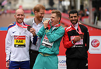 Derek Rae GBR (silver), Michael Roeger AUS (gold), and Abdelhadi El Harti MAR (bronze) pose with HRH The Duke of Sussex with their respective medals in the T46 World Para Athletics Marathon Championships. The Virgin Money London Marathon, 28 April 2019.<br /> <br /> Photo: Joe Toth for Virgin Money London Marathon<br /> <br /> For further information: media@londonmarathonevents.co.uk