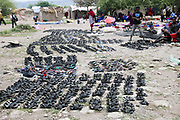 Africa, Tanzania, Frontier Market selling shoes from old tires The goods are placed on a blanket on the ground