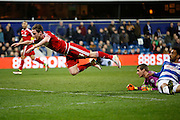 Middlesbrough FC midfielder Adam Forshaw (34) gets a shot away before being brought to ground during the Sky Bet Championship match between Queens Park Rangers and Middlesbrough at the Loftus Road Stadium, London, England on 1 April 2016. Photo by Andy Walter.